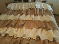 This is a burlap shower curtain. Six ruffles from regular burlap and from cream burlap.