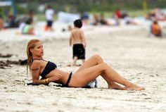 Michelle Hunziker Photos - Michelle Hunziker and Tomaso Trussardi Go for a Swim - Zimbio