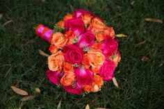 Pink and orange wedding flowers - love this! It would totally compliment the blue I'm planning to have