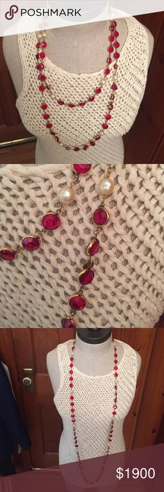 """Vintage 1981 Chanel Pearl & Red Sautoir Necklace. Vintage 1981 30"""" Chanel Pearl & Red Sautoir Necklace. Estate piece by Chanel with Strass red crystal chiclets and oblong faux pearls in a gold-plated setting. Worn less than four (4) times for less than two (2) hours each outing. Pristine condition. Not accepting offers. The price is the price. Selling because brain mets have reordered my priorities. No trades. No PayPal. CHANEL Jewelry Necklaces"""