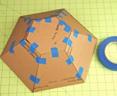 Patterns for cardboard houses | Using small bits of tape, tape the pieces together so they create ...