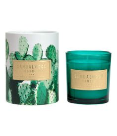 Dark green/Sandalwood. Large scented candle made of wax and paraffin in a glass holder with a printed text motif. Supplied in cardboard box with lid. Burn