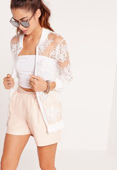 Bag a bomber jacket this season and embrace lavish embroidery. Featuring a cream hue, bomber style, mesh body and lace detailing, this is a statement piece to be rocking day through till the night. Team with a basic top, denim shorts and he...