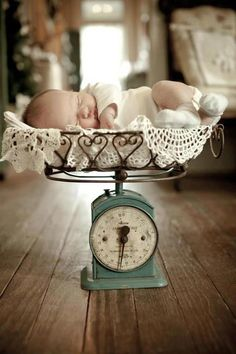 Vintage baby scale with a precious new born. Notice the little hearts on the basket...so sweet!