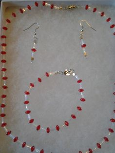 Check out this item in my Etsy shop https://www.etsy.com/listing/184537065/20-and-12-beaded-necklace-red-clear-and