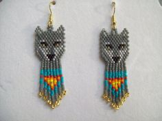 These Native Grey an Turquoise Wolf are custom made by Elaine. They are made in White, Black, Grey, Turquoise, Red, Orange, Yellow and Gold Delica Beads. Very cute and light. Nice Gift for anyone. Love the share my work with people. If you have any Questions just ask. Thanks for looking.