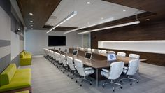 "Redesign of Adobe's San Jose headquarters with complex audiovisual systems including a high tech boardroom with four tracking video cameras, a 103"" plasma display, and 11 touch screen displays that retract into the boardroom table. http://www.bcciconst.com/what-we-build/interiors/adobe/"