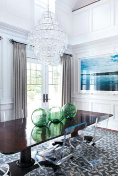 Modern crystal chandelier with antique mahogany table & lucite chairs