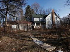 Police probe mystery 'confinement room' found in basement of abandonedhome | National Post