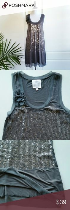 """NWOT Romeo & Juliet Couture Gray Sequin Dress Romeo and Juliet Couture gray sequin dress *Size Large - Underarm to underarm : 17"""" flat / Shoulder to hem : 34"""" *95% rayon / 5% spandex - Super soft think jersey material - Hand wash recommended  *Sequin and flower corsage details / Raw, unfinished hem  *New without tags. No sequin missing. *No trade Romeo & Juliet Couture Dresses"""