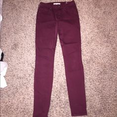 Maroon Bullhead denim high rise skinniest jeans In great condition! Pictures are true to the actual color (maroon/Crimson). They are high-rise. Small bleach stain on back pocket (pictured) but barely noticeable! Bullhead Jeans Skinny