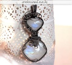 Rainbow moonstone and sterling silver wire wrapped by amorfia
