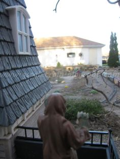 Haunted House - Ghost looking out from the top of a G-Scale Garden Train Haunted House