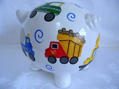 This hand painted piggy bank was created for a special order and turned out fabulous! So much attention was to the detail on each construction truck. Bright colors that kids love in red, green, yellow, blue, orange, tan, brown, black and gray complete each truck. *Personalized with