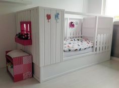 IKEA's KURA bed is a budget staple in children's rooms, but most parents configure it in a lofted position to free up more floor space. I've often wondered why anyone wouldn't do that? One reason is if your child is too young, you can start them in this and then flip it into a loft. An even better answer, perhaps, is that the frame of the Kura lends itself so easily to creative interpretation and decorating. Here are examples of ways parents have gussied up their Kuras:
