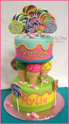 Double birthday cake for two sweet little girls. Cakes covered in fondant, with gum paste handmade candy, and cupcake ice cream cones