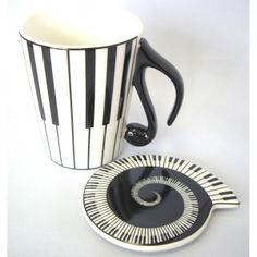 Piano keyboard mug with lid currently in collection
