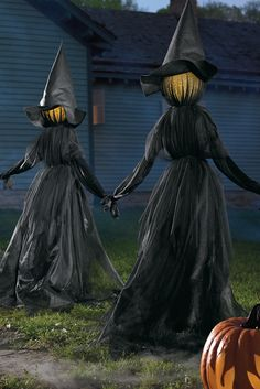 Easily craft the biggest spine-tingling spectacle on the block with a gloomy gathering of our lighted Holding Hands Witches on your front lawn.