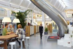 Popular: Lego is another company to have installed a slide in its vibrant working space, as well as lush bonsai gardens built into the tables