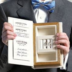 Concealing 3 ring holders and two jewelry compartments, this A Promise Made wedding ring box looks just like a book you'd take from a bookcase shelf.