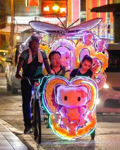 Electrified pedicabs carry tourists through the night streets of Malacca Malaysia. Each vehicle is decorated uniquely. Photo from my book #VanishingAsia