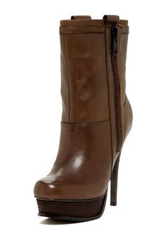 Simple and sexy brown boots! Get in the MYX this season, with the finest bottle in blue at MYXFusions.com!