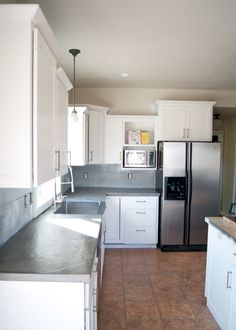 DIY Concrete Counters Poured over Laminate - Step by step on what to do and what not to do. Including how to pour around a stainless steel apron front sink. Modern Kitchen Cabinets, Kitchen Redo, Kitchen Furniture, Kitchen Remodel, Modular Furniture, Kitchen Ideas, Furniture Market, Concrete Countertops Over Laminate, Diy Countertops