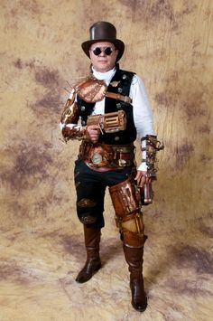 An awesome return customer and friend all decked out at Dragon Con! Picture taken by Stephen Lesnik I did not make the Gun, Top Hat, Glasses or his cloths. I did Make his Belt, both bracers, leg pi...