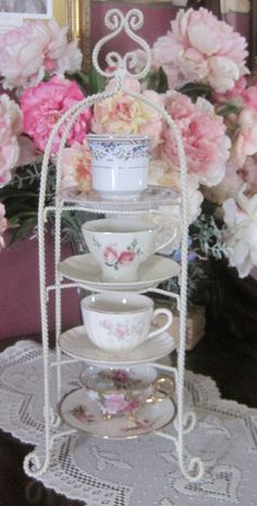 Vintage tea cup holder. alternative but less ideal solution to vertical wall-mount rack