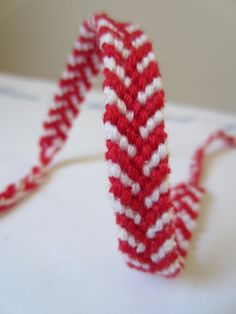 Staggered Chevron Braided Friendship Bracelet in Red and White. £4.20, via Etsy.