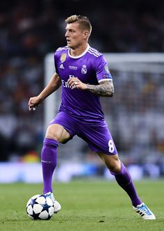 Toni Kroos of Real Madrid CF runs with the ball during the UEFA Champions League Final between Juventus and Real Madrid at National Stadium of Wales on June 3, 2017 in Cardiff, Wales.