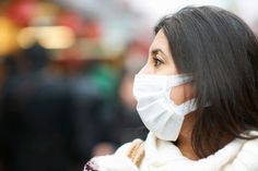 Close up of mature woman wearing pollution mask, Tokyo, Japan