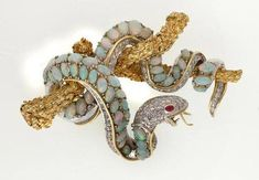 An opal, diamond and ruby brooch, 14ct white and yellow gold.