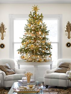 Great idea: Instead of one huge #Christmas tree, decorate a few small ones, like this gold table-top tree from @Eddie Persson Ross