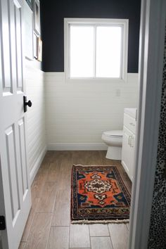 Need bathroom vanity lighting inspiration? This style board shows the different styles you can incorporate into your bathroom that work with shiplap walls. You can have a stylish bathroom at any price point. Wood Floor Bathroom, Navy Bathroom, Downstairs Bathroom, Bathroom Vanity Lighting, Bathroom Rugs, Small Bathroom, Bathroom Ideas, Budget Bathroom, Dream Bathrooms