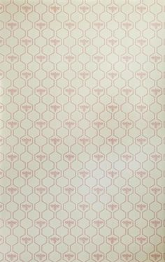 This geometric honeycomb pattern interspersed with bees feels very organic. It is a great pattern, printed in a deep charcoal, light gold, and soft pink. Wallpa