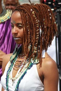 Red, reddish brown, and brown colored locs, loc jewelry, loc wraps, decorating locs, locs styles, long locs styles, beads for locs, loc beads.