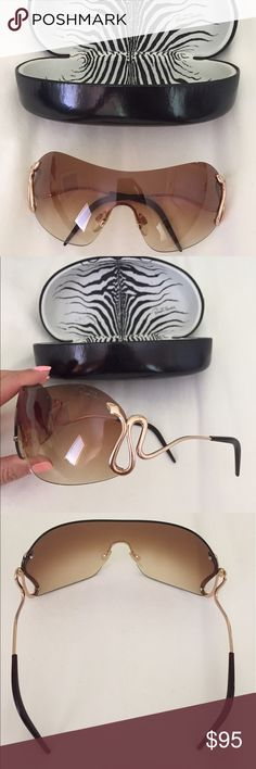 Roberto Cavalli Women's Sunglasses Roberto Cavalli Brown and Gold women's sunglasses. Like new, No signs of use or wear, hardly ever worn. Brown lenses with a fade and gold frame detail Roberto Cavalli Accessories Sunglasses