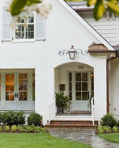 Current exterior inspiration!  Also a splurge + save lamp round up on Beckiowens.com today! White brick exterior.