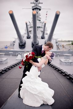 A wedding on board the deck of the USS Alabama Battleship. Photography copyright Oeil Photography - http://oeilphotography.com