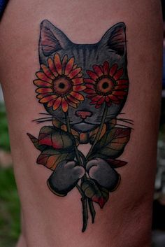 I like this idea with prettier sunflowers or maybe a type of Lilly. and then possibly sugar skull or lioness instead of a house cat.
