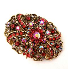 Hey, I found this really awesome Etsy listing at https://www.etsy.com/listing/209917170/vintage-red-rhinestone-brooch
