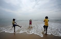 Boys play soccer on Marina beach in the southern Indian city of Chennai
