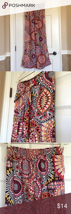 Bell Bottom Patterned Flare Pants Only worn once. Bell bottomed flare pants with colorful pattern. Ties in front, elastic in back of waist. Super comfy and flowy. Xhilaration Pants Boot Cut & Flare