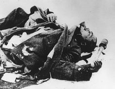 Dead German soldier is still holding on to a hand grenade , as he lie`s frozen in the snow - on a battlefield near Stalingrad March 22 1943