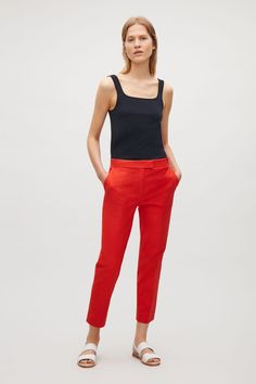 A slim, tailored fit with a comfortable stretch, these cotton-mix trousers have a Designed to sit just below the waist and cropped at the ankle, they have crisp press folds, slanted side pockets and a zip fly fastening. Cos Trousers, Slim Fit Trousers, Trousers Women, Pants For Women, Red Pants, Black Pants, Work Pants, Fitness, Model
