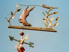Sea Otter Diving Weather Vane by West Coast Weather Vanes. This Sea Otter mother, otter pup, and starfish weathervane was customized by using copper with the kelp leaves and sea floor were made in brass.