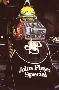 Ayrton Senna (John Player Team Lotus) analysing lap times on an analog Longines monitor ""