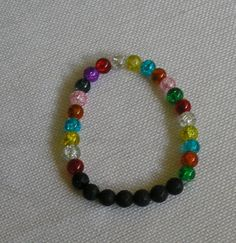 Essential oil diffusing bracelet, surrounded by sparkling multi colored acrylic beads by HooksBrushesandBeads on Etsy