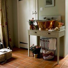 Team a copper bateau-style basin with bathroom furniture such as a console table to create a washstand — your plumber can make adjustments when fitting.